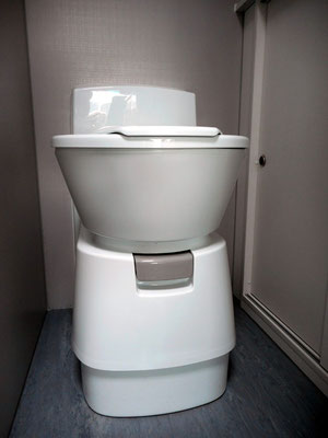 cassette style toilet with swivel adjustable seat