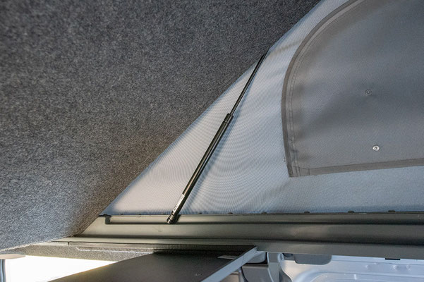 Upper bed in Trafic campervan roof, gas strut operated