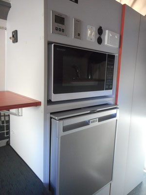fridge and microwave in easy to reach height, micerowave and operation panels above