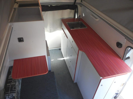 kitchen cabinets with lots of bench space (stove is stowed away in one of the drawers)