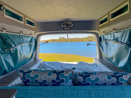 a dream VW Splash bed with headrest up to enjoy the view to teh outside
