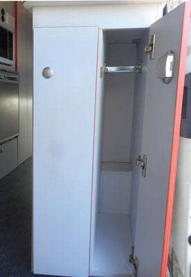 mini wardrobe next to pull out pantry in entry area