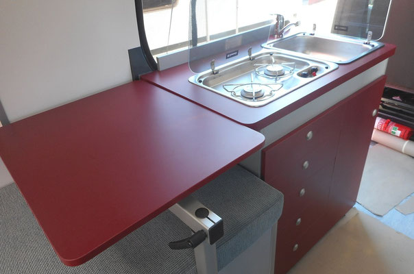 the table can be swiveled and positioned as a kitchen work bench extension