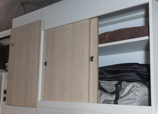 full height cabinetry on driver side rear in Hiace camper