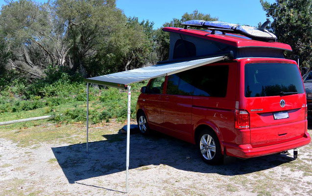 VW T6 Multivan Comfortline red with tilted Euro roof and Fiamma awning