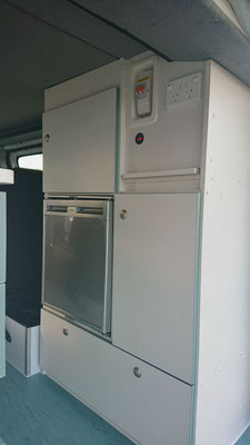 cabinetry in rear on driver side with fridge