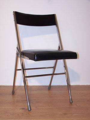 Chaise vintage pliante chromée et simili cuir noir