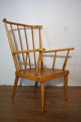 Véritable fauteuil éventail de la maison Baumann avec coussins