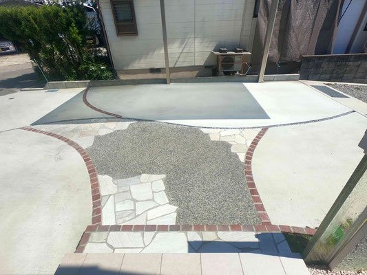 曲線の石張りのアプローチがかっこいいオープン外構