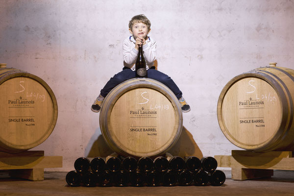 """Single Barrel"" Champagne by Paul Launois : Paul Launois himself, grinning sillily on top of a barrel (credit olakaphotography) 