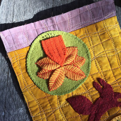 Handmade felt from upcycled 100% wool sweaters appliquéd on art quilts