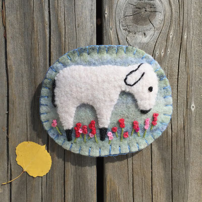 Sheep pin brooch with pale blue background