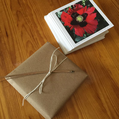 Sets of 10 different photo cards with matching envelopes are packaged with eco-kraft paper tied with string