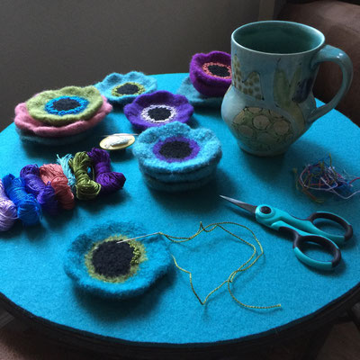 Early morning stitching - making french knots on felted wool flower pin brooches