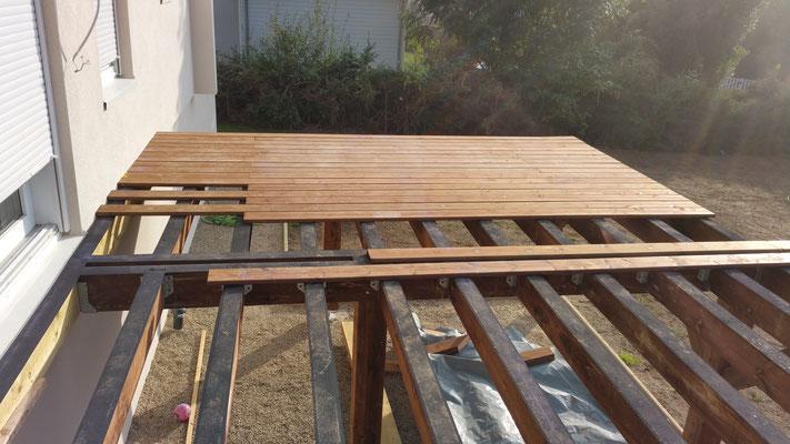 Protection entre bois par membrane epdm.