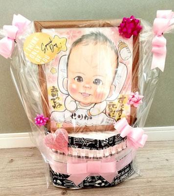 赤ちゃん似顔絵の下には沢山のオムツ