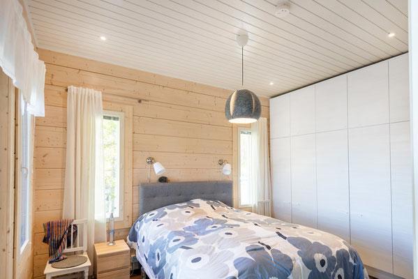 Maison en bois chambre