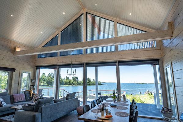 Maison en bois façade vitrée