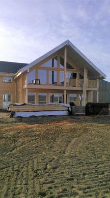 Baie vitrée maison bois