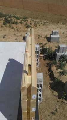 Tube raidisseur maison en bois