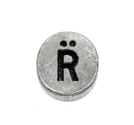The Relate logo bead - a symbol of their commitment to social upliftment