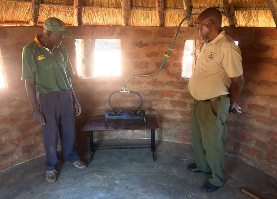 Mr Sibanda and colleague inspecting a newly installed gas stove