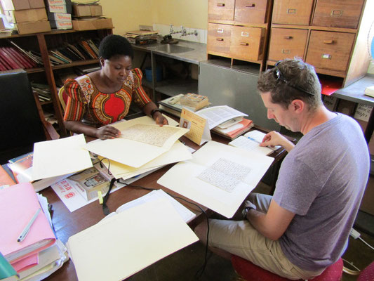 Jared McDonald reviewing original Livingstone letters in the museum archives