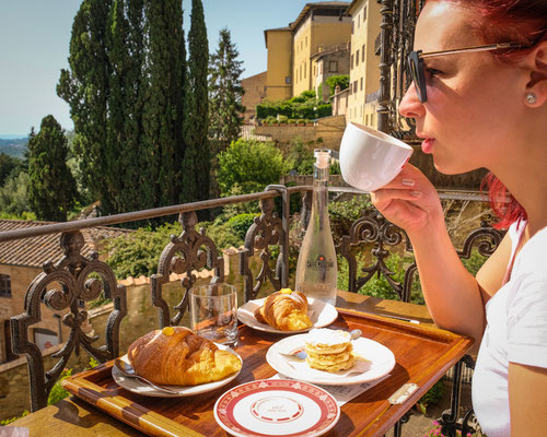 Drinking coffee at Caffee Poliziano in Montepulciano, Italy