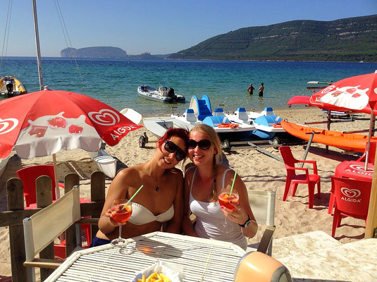 Mugoni beach and Aperol time, in background Capo Caccia