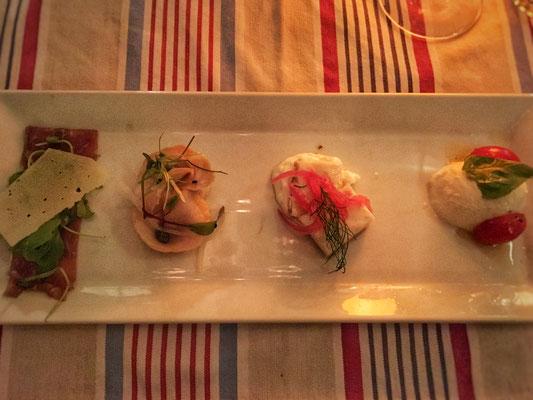 Variation of antipasti: Prosciutto with pecorino cheese, Mozarella with tomatoes, Vitello, and piece of fish