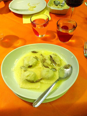 Hand made Ravioli filled with meat in butter sauce covered with fresh grated pecorino cheese