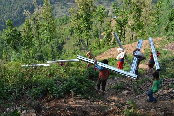 Nepal Earthquake Support by BE YOGI Beate Laudien - carrying tin supplies into the villages