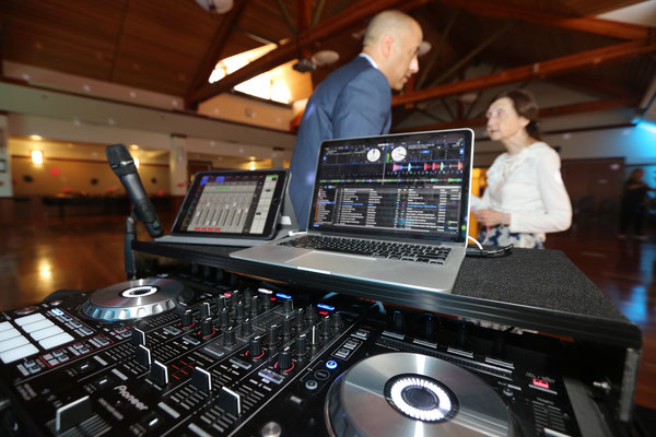 Stepping out from behind the console listening to a guest, at the Summer Senior Dance, Mountain View, CA