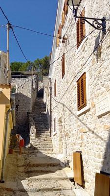 einige Bewohner müssen Treppen steigen, um zu ihrem Haus zu gelangen