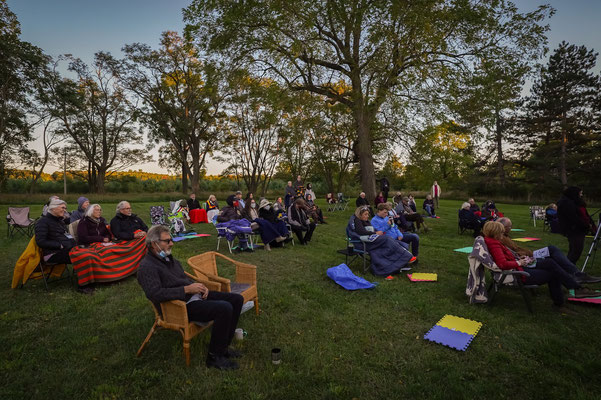 Audience physically distanced during a crisp evening during Garden Concert One.