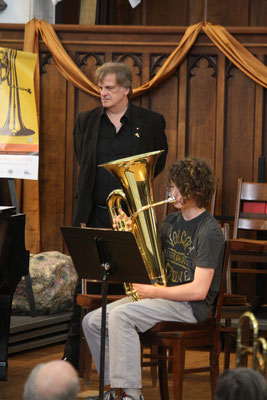 Scott Irvine, True North Brass's tubist, observes Josh Lesperance's technique on the instrument during the Brass Festival open coaching session.  Josh, a Grade 8 student, also participated in the Don E. Johnson Brass Ensemble concert the night before.