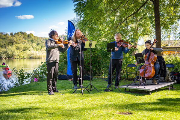 The Surreal Quartet enjoy a warm afternoon after a few chilly concerts.