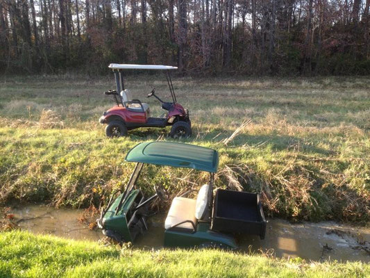 """Lifted and 4 Wheel Drive Units in Action, Keep in mind the Green Unit has 9.5"""" of lift over a standard unit. It's in about 2 foot of water and tearing through the ditch with no problem"""