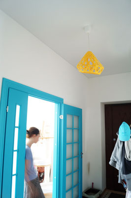 Yellow pendant with blue doors