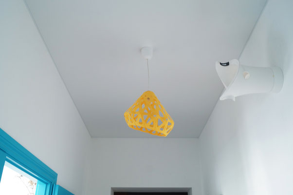 Yellow pendant light in the interior