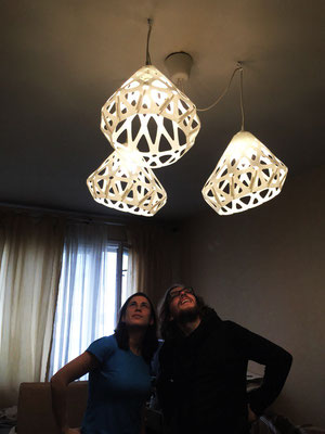 Installed white triplet chandelier