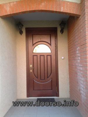 Металлические входная дверь с овальным стеклопакет. В Рузе.