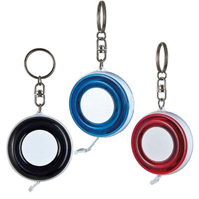 Código PRO 005  LLavero flexo metro.  Cinta flexible de plástico de 1.5 m.  Material:    Plástico.    -  Tamaño: 5.3  x 10.4  cm