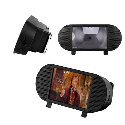 Código CEL 054  - AMPLIFICADOR DE IMAGEN -  Amplificador de imagen para smartphone con bocina bluetooth y radio FM. Batería recargable para 3 horas de reproducción aproximadamente. Incluye cable cargador USB.  Material: Plástico Tamaño:  30 x 12.3 cm