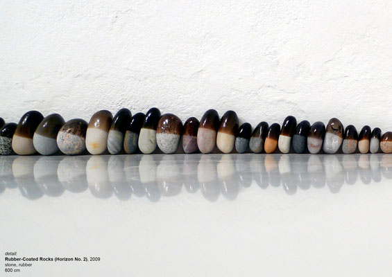 "<a href=""http://www.nidasinnokrot.com/text/rubber-coated-rocks/"" target=""_blank"" style=""color: #FFFFFF; float: right;"">info</a>"