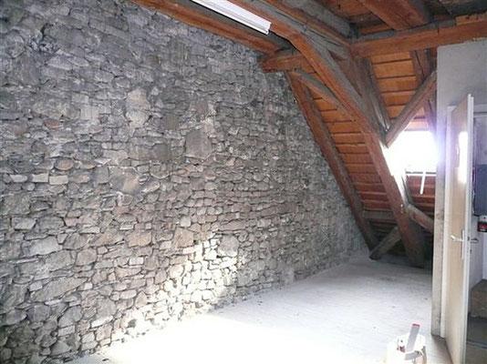 Bruchsteinwand zur Erweiterung der Raiffeisenbank