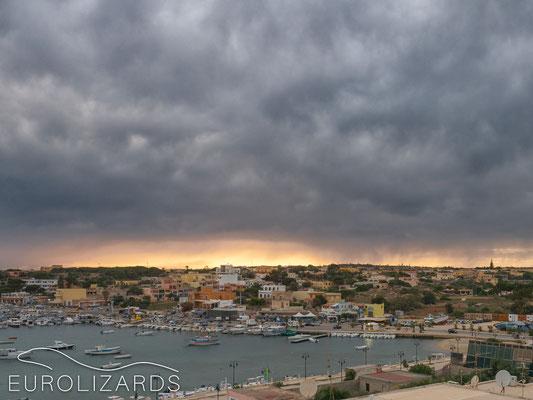 Rain clouds over Lampedusa harbor…