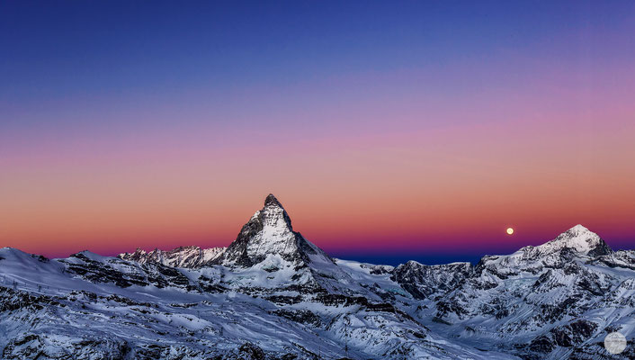 "Bild: full moon next to the Matterhorn, Zermatt, Switzerland, ""full moon is going downV3""; www.2u-pictureworld.de"