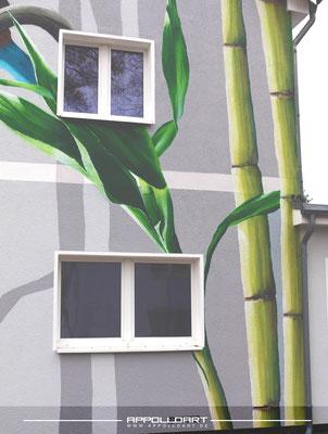 Graffitigestaltung einer Fassade mit frischen naturellen Motiven