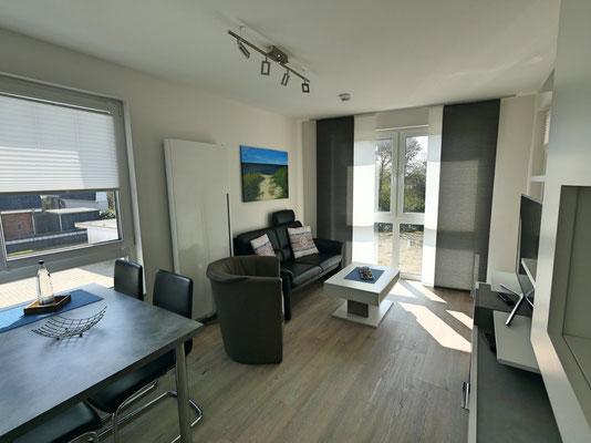 Residenz Windjammer Nr. 11 der helle und freundliche Wohn- und Essbereich, ideal für bis zu  3 Personen
